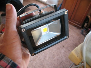 And he sent me four of these cute little things, on the theory that the Lair needs exterior lighting. Which I must confess, sometimes it kind of does. I'm going to mount two in the front yard, and one inside the powershed to replace the 110V lamp that never has worked right. Don't know what I'll do with the fourth. Something.
